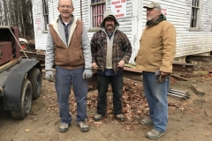 Rodney-Laughton-left-with-Josh-Steve-Merry-after-move-of-schoolhouse-to-new-foundation-2019-11-20-Photo-by-Karlene-Osborne
