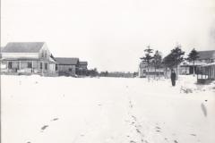 Higgins Beach - Ernest Elliott standing in street in winter - Higgins Beach, Scarborough, Maine - 98.25.05